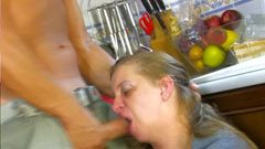 The younger man fucks the housewife in the kitchen