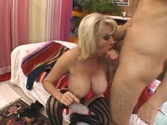 Buxom mommy with shaved pussy